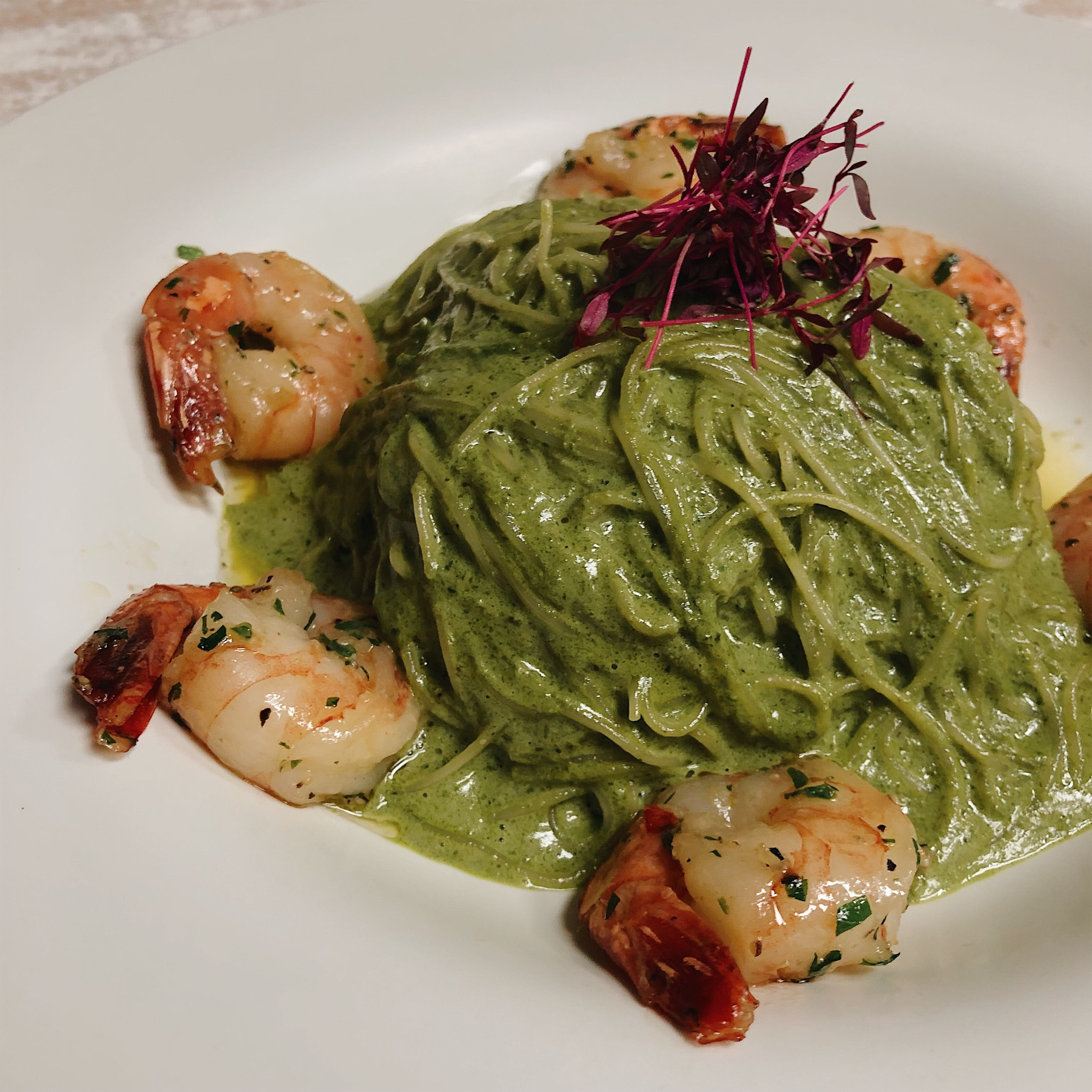 Capellini with tiger shrimp and pesto sauce