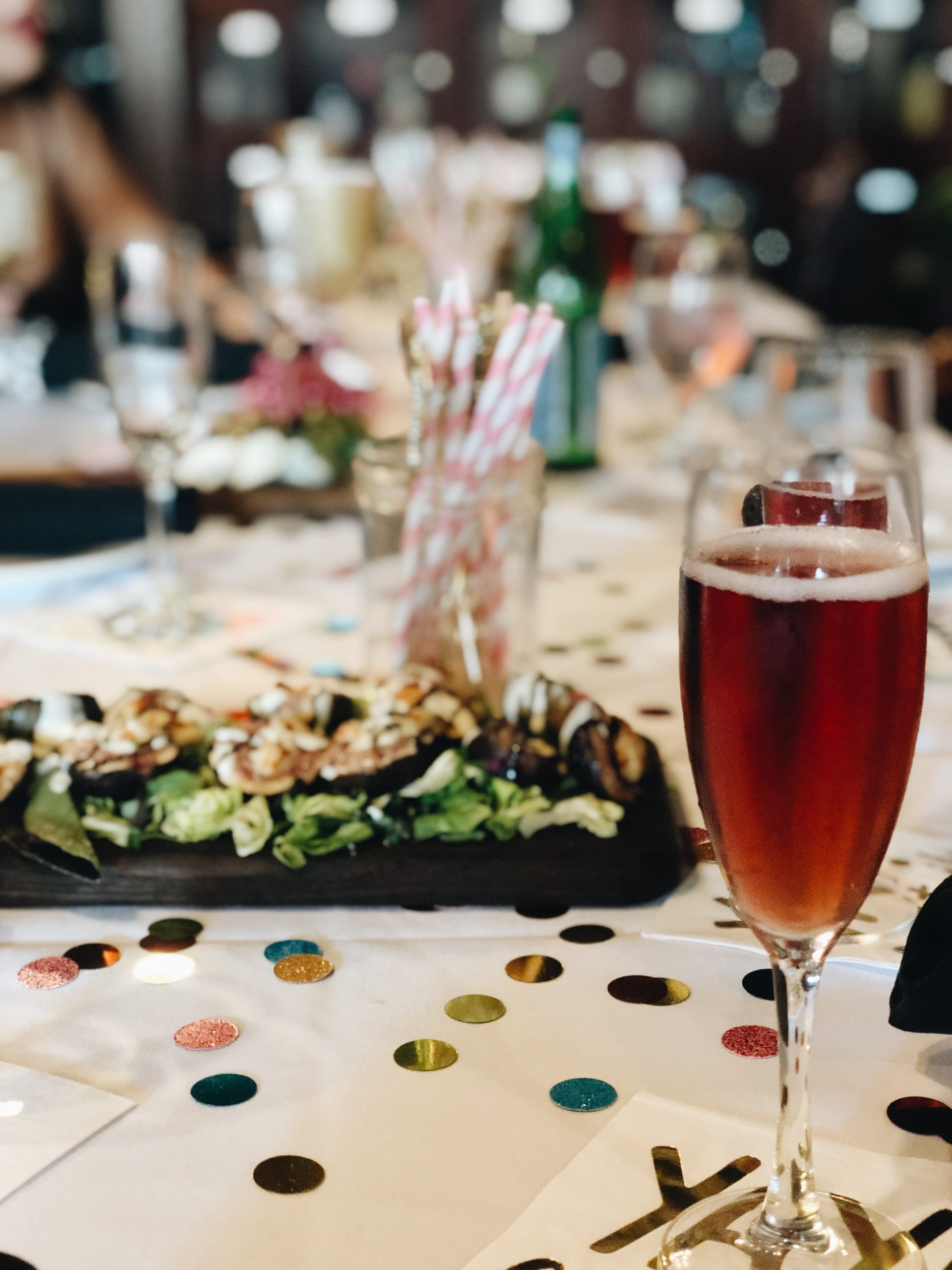 Glass of Rose Brut, table setting, confetti, party decor