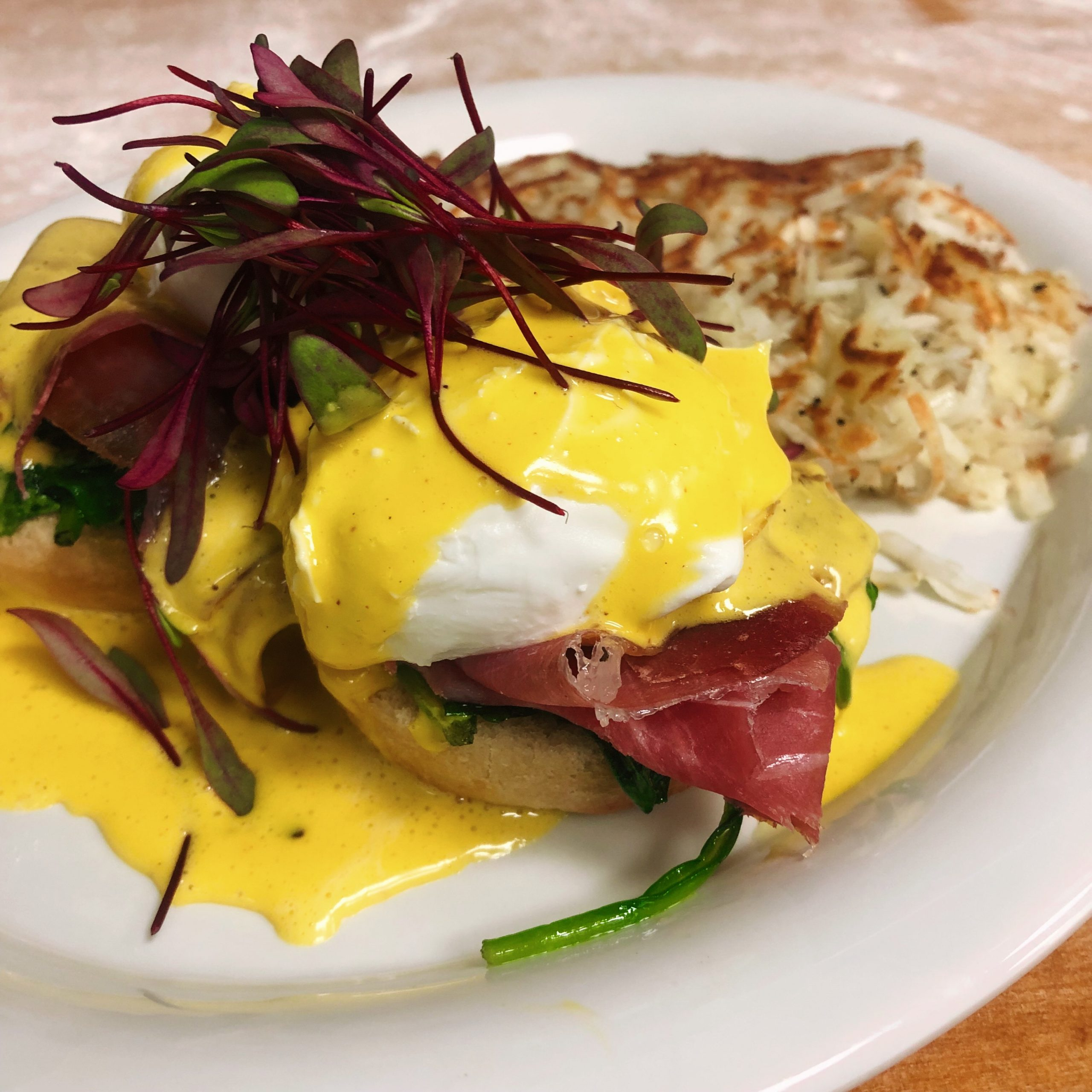Poached egg, procuitto, arugula, served on a homemade muffin topped with hollandaise sauce