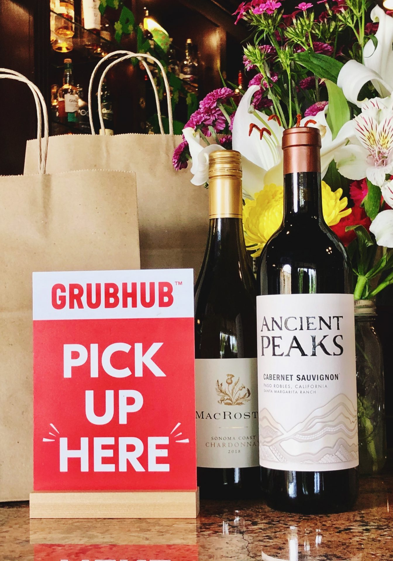 Delivery bags, wine, and service options.