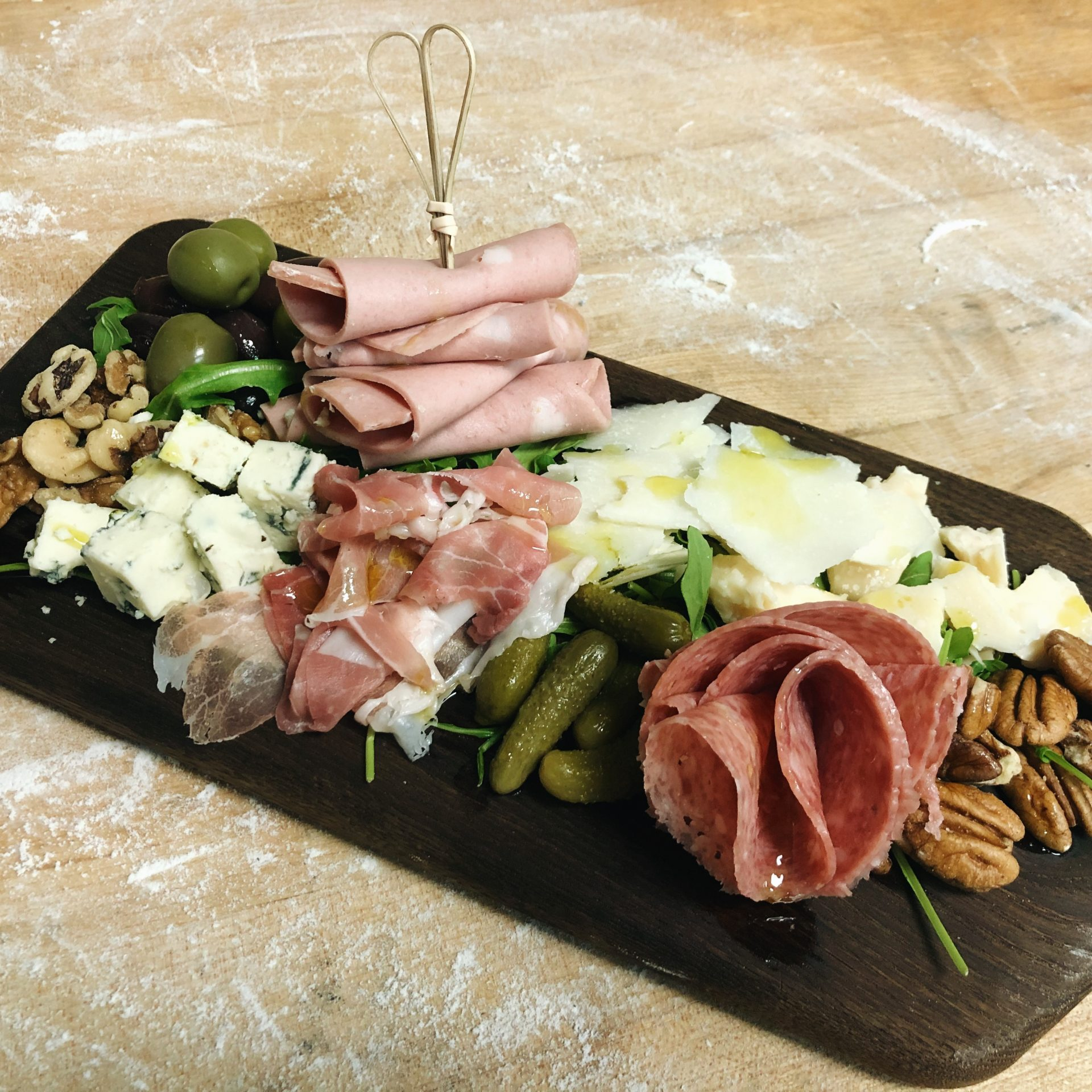 Meats, cheeses, nuts, olives, pickles.