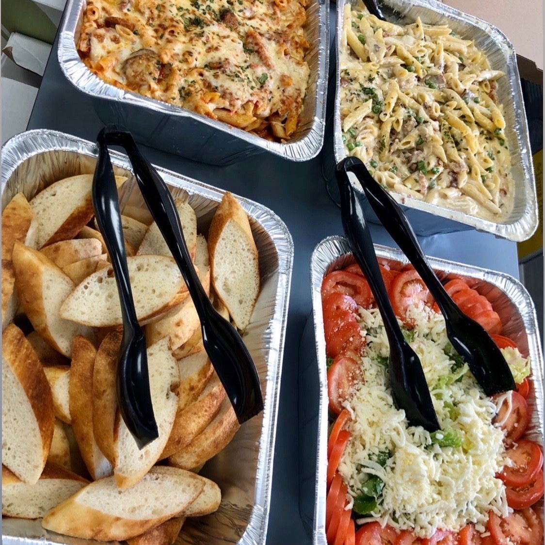 Medium & Large Trays TOGO displaying pasta, read, bruschetta and pizza.